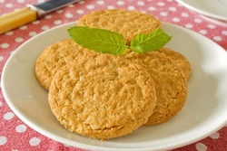 Brown wholemeal biscuits on a white plate