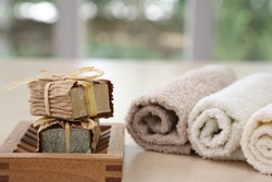 Soaps,towels and wook basket with a blurred background