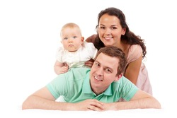 Portrait of happy family looking at camera in isolation