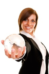woman holding globe in her hand on white