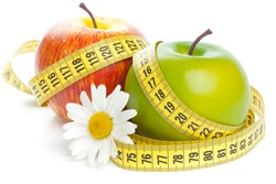 Apples, flower and measuring tape. Concept of healthy food.