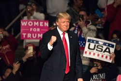 "HERSHEY, PA - DECEMBER 15, 2016: President-Elect Donald Trump gives a ""Fist Pump"" as the confidently arrives on stage to deliver a speech at the ""Thank You"" Tour rally at the Giant Center."
