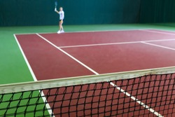indoor tennis court playing athlete