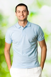 Portrait of young attractive smiling man, outdoors