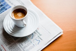 cup of Espresso on newspaper