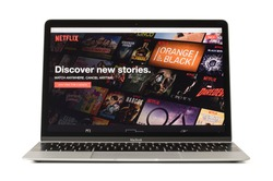 RIGA, LATVIA - February 06, 2017: Netflix,the worlds leading subscription service for watching TV and movies on 12-inch Macbook laptop computer.