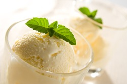 Delicious vanilla ice cream with mint leaves.