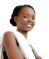 Portrait of a young afro-american woman after workout smiling at the camera against white background