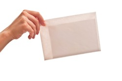 White envelope in woman's hand. Isolated on white