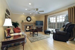 Family room with fireplace and doors to patio