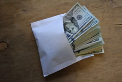 Hundred-dollar bills. Paper money of the United States.  bundle of dollars in cash