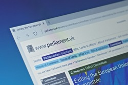 SARANSK, RUSSIA - FEBRUARY 15, 2017: A computer screen shows details of Parliament of the United Kingdom Exiting the European Union Committee page on its web site. Selective focus.