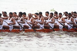 ALLEPPEY, INDIA - AUGUST 14 : A Snake boat team participating in the Nehru Trophy Boat race August 14, 2010 in Alleppey, India.