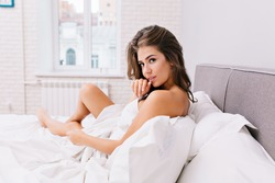 cute girl lying in bed