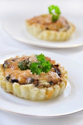 tart appetizer with mushroom and cheese