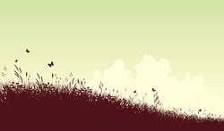 Editable vector silhouette of a grassy meadow and clouds with copy space