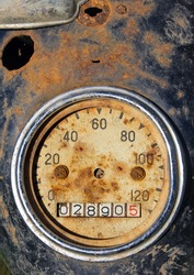 Old rusty speedometer.