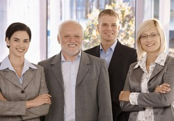 Portrait of smiling businessteam standing in office.