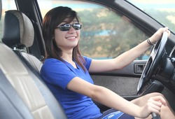 smiling asian lady driver