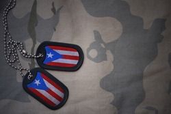 army blank, dog tag with flag of puerto rico on the khaki texture background. military concept