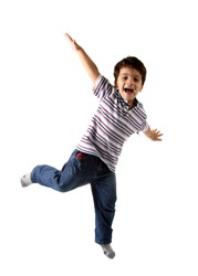 A Brazilian and caucasian kid playing on a studio with white background and isolated on white. The child is wearing jeans, shirt and shows a real expression of fun.