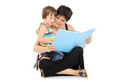 Smiling mother and boy reading a book together isolated on white background