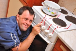 down syndrome man with stove