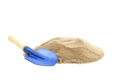 Blue spade with a pile of sand isolated over white