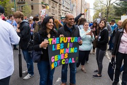 "NEW YORK - APRIL 22: An unidentified man and woman hold a sign that reads ""The Future Lies In Mining Genes Not Coal"" during the March For Science on April 22, 2017 in New York."