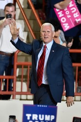 HARRISBURG, PA - APRIL 29, 2017: Vice President Mike Pence waves to supporters as he arrives on stage at a Trump campaign rally marking 100 days in office at the Farm Show Complex and Expo Center.