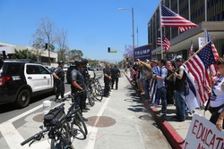LOS ANGELES California- May 1, 2017: Los Angeles Police separate both Protesters and Supporters of President Trump at a May Day Protest Rally on May 1, 2017 in Los Angeles, California.