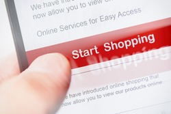 smartphone touch screen with red button start shopping. business e-commerce concept.