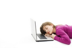 Picture of a cute teenage girl sleeping on her laptop computer, isolated on white background