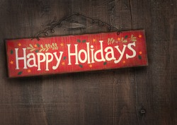Holiday sign on distressed wooden wall