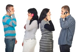 Two couples talking by phone mobiles and each of them standing in profile  isolated on white background