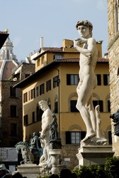 the square in Florence, Italy, showing many statues, statue of David in the foreground