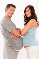young pregnant couple showing big stomach