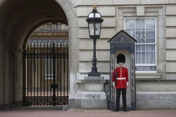 LONDON, ENGLAND - AUGUST 25: Sentry of the Grenadier Guards posted outside of Buckingham Palace on August 25, 2006 in London, United Kingdom..