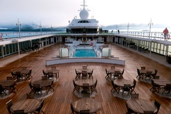 pool deck scene onboard luxury cruise liner traveling alaska's inside passage at dawn