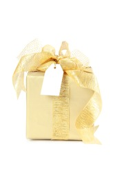 Golden christmas gift box with blank paper tag isolated on white background