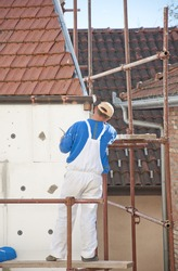 The worker placed the insulation on the building
