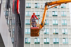 cleaning skyscrapers outside with a crane  scissor  lift  hydraulic  platform