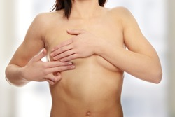 Breast cancer check- Woman holding her breast