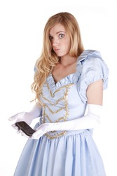 A woman dressed like Cinderella is holding a cell phone wondering what to do with it.