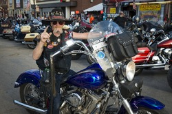 Sturgis, South Dakota - August 9, 2014: Rider in the main street of the city of Sturgis, in South Dakota, USA, during the annual Sturgis Motorcycle Rally