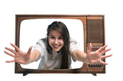 Old vintage tv with young woman arms outstretched from screen