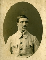 Vintage portrait of a young men. The shot was taken around 1910 year.