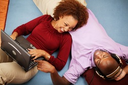 Couple on floor with headset and laptop