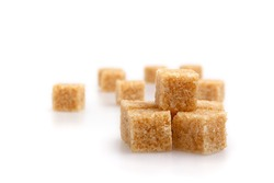 Brown Sugar cubes isolated with soft shadow. Fucus limited.