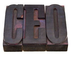 chief executive officer (CEO) acronym in antique wood letterpress printing blocks, stained by color inks, isolated on white